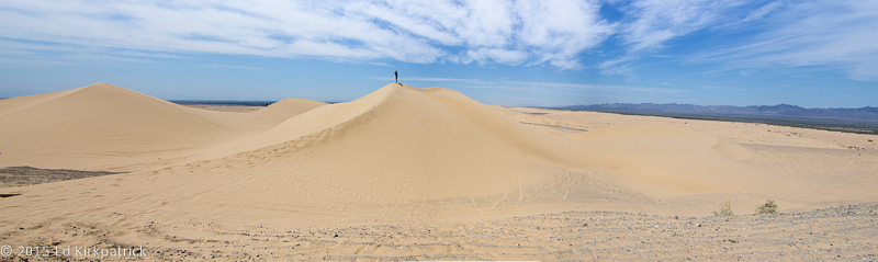 Not Sean Connery, but a full grown man on top of the dune.