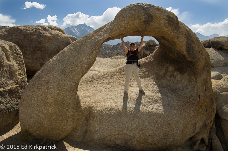 Marti holding up the Mobious Arch in the Alabama Hills.